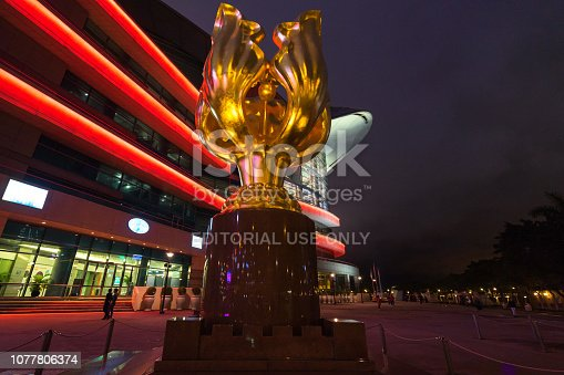 istock Night view of Golden Bauhinia Square. The statue was built to mark the 1997 handover from Britain to China 1077806374