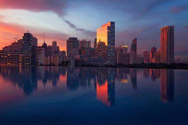 night view of makati financial district, philippines - philippines stock photos and pictures