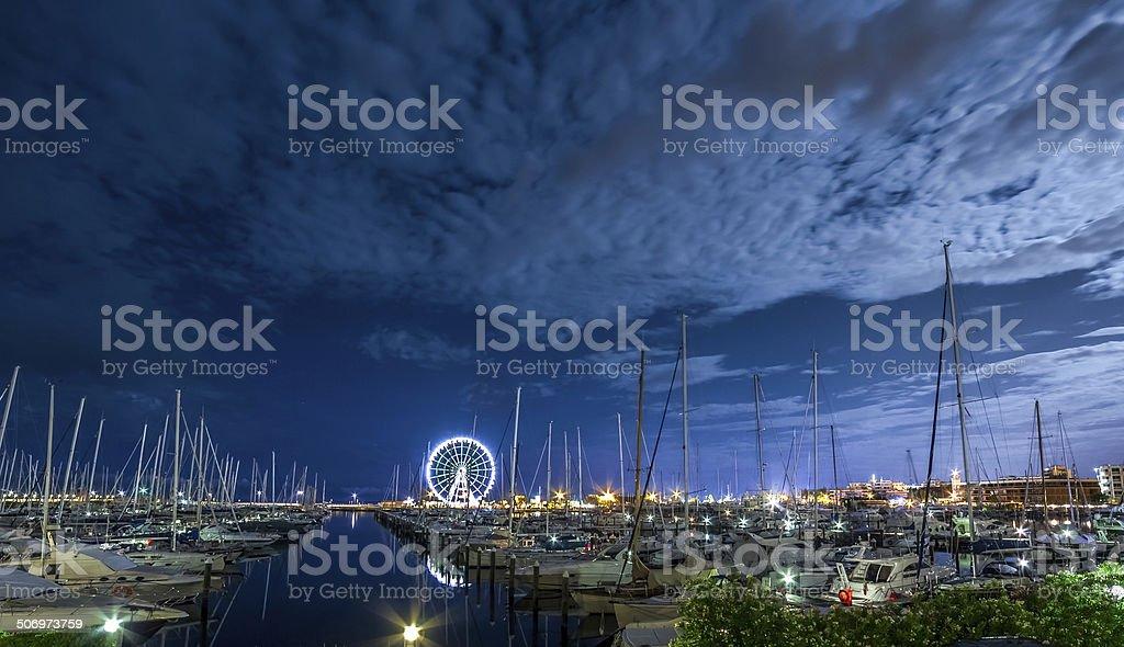 RIMINI, night view of marina with ferris wheel stock photo