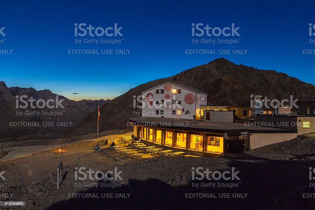 Night view of mountain house at Diavolezza stock photo
