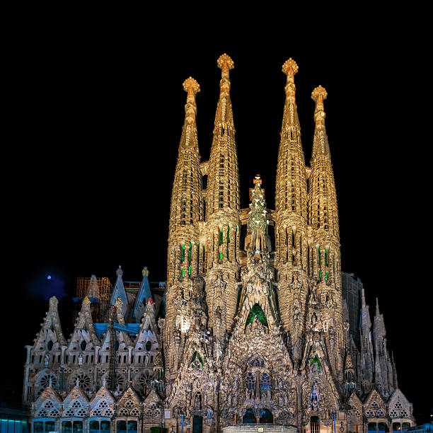 Night view of Nativity facade of Sagrada Familia cathedral in Barcelona stock photo