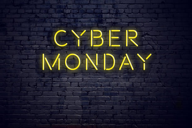 night view of neon sign with text cyber monday - cyber monday стоковые фото и изображения