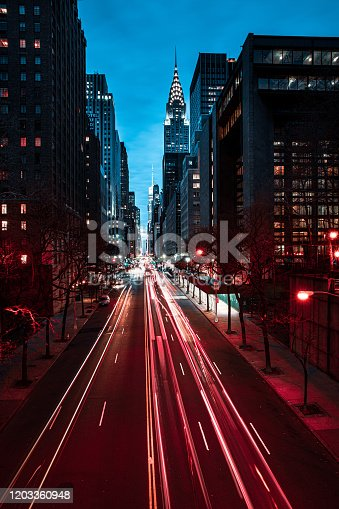 Night view of New York City midtown district  and blurred cars
