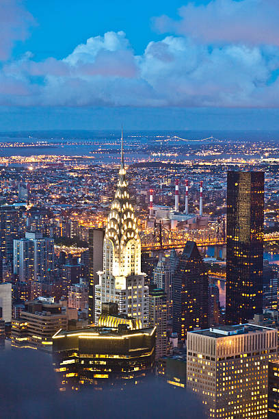 a night view of new york from the empire state building - chrysler building stock photos and pictures