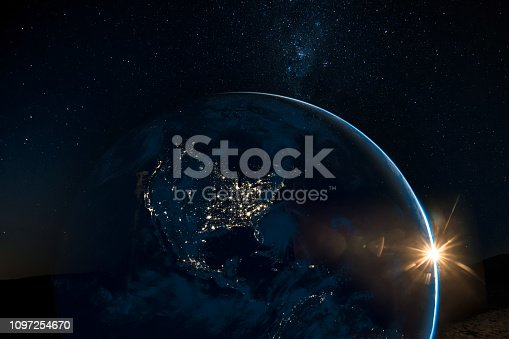 499002117istockphoto Night view of north America from the satellite to the glowing city lights on the sunrise from the east. Elements of this image are furnished by NASA. 1097254670