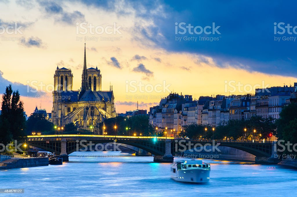 night view of Notre Dame de Paris Cathedral stock photo