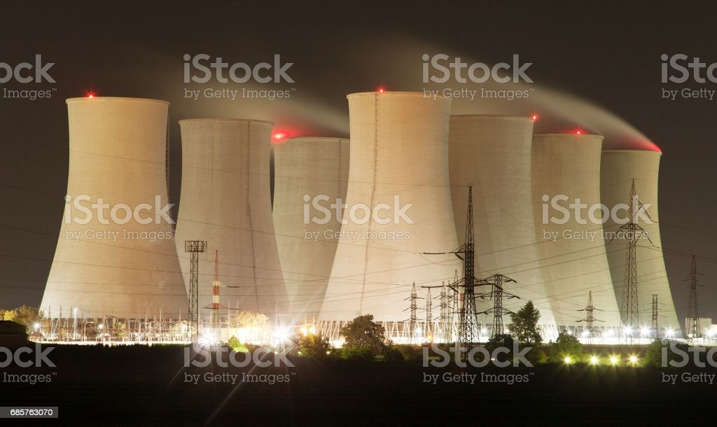 Night view of nuclear power plant and cooling towers stock photo