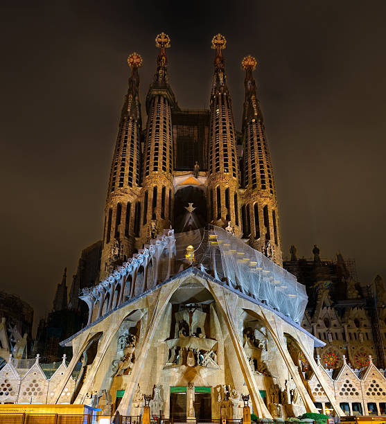 Night view of Passion facade of Sagrada Familia cathedral in Barcelona stock photo