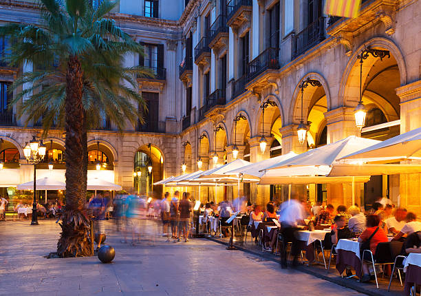 night view of Placa Reial night view of Placa Reial with restaurants in summer. Barcelona barcelona spain stock pictures, royalty-free photos & images