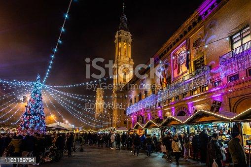 Night view of Plaza del Pilar, the main square of Zaragoza historic center during Christmas time. Zaragoza, Aragon, Spain, December 2018