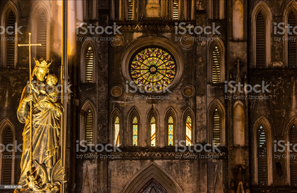 Night view of Regina Pacis (Queen of Peace) Statue in front of St. Joseph's Cathedral, Hanoi, Vietnam. St. Joseph's Cathedral is a Neogothic style church that serves as the cathedral of Roman Catholic royalty-free stock photo