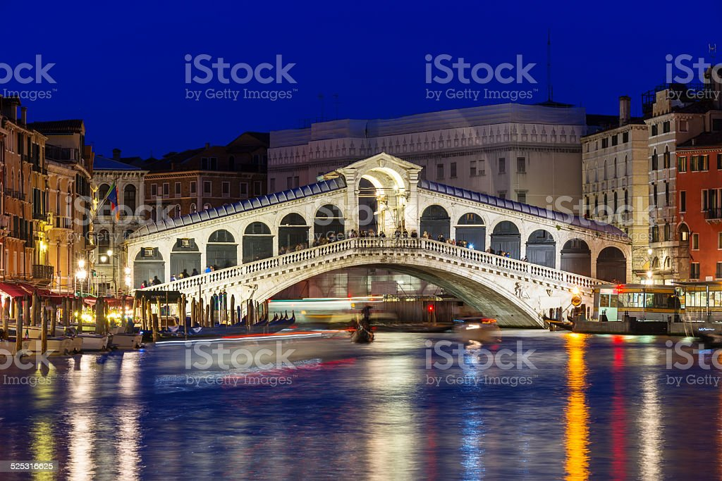 Night view of Rialto bridge and Grand Canal in Venice stock photo
