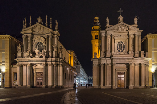 Night view of San Carlo square with twin churches of San Carlo and San Cristina, an example of baroque architecture, Turin, Italy