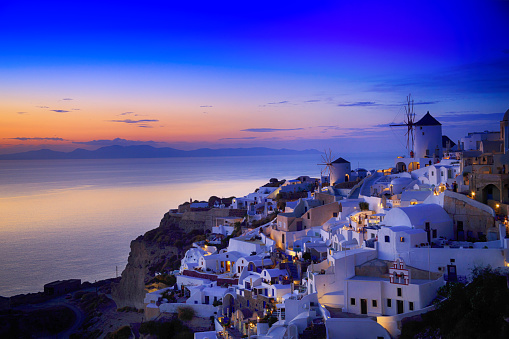 Night view of Santorini island, Greece. Buildings and sea.