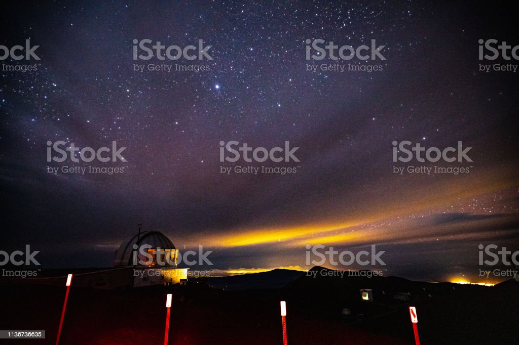 Night view of Stars and United Kingdom Infrared Telescope(UKIRT) on Mauna Kea Mountain stock photo
