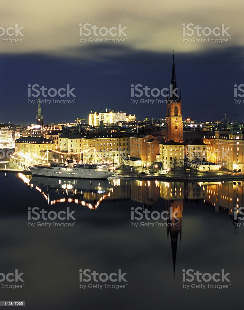 Night view of Stockhoplms old city with reflection stock photo