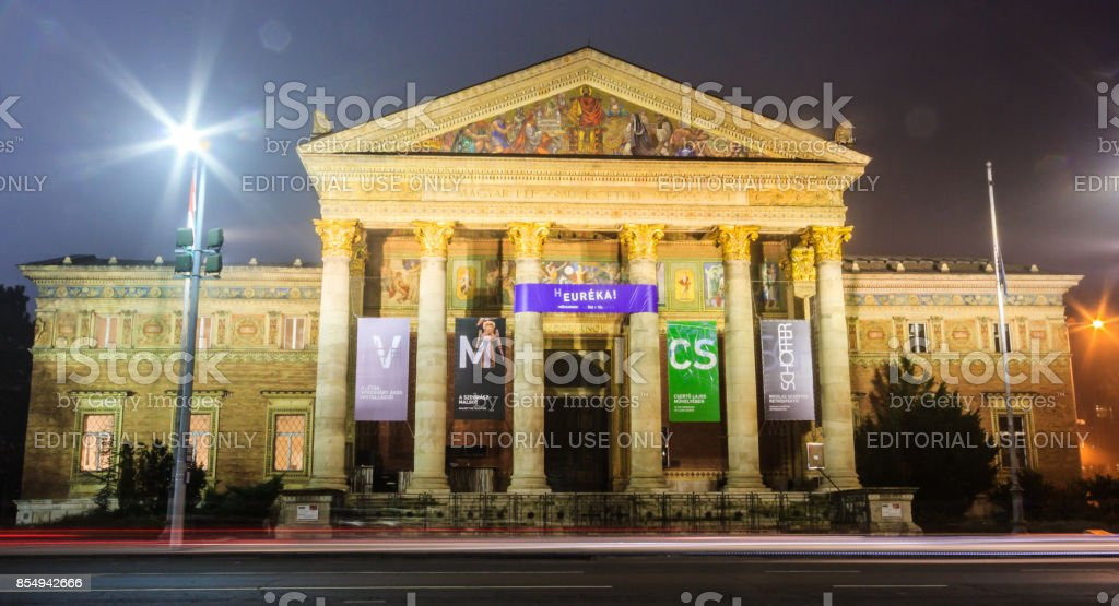 Night View of The Budapest Hall of Art or Palace of Art (Mucsarnok Kunsthalle), a contemporary art museum and a historic building on Heroes's Square. Neoclassic structure and Greek Revival style portico with main entrance. stock photo