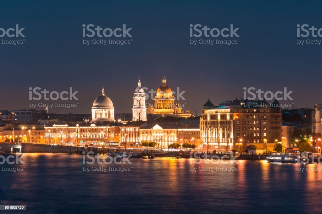 Night view of the Church of St. Catherine the Great Martyr and St. Isaac's Cathedral at the Neva River. royalty-free stock photo