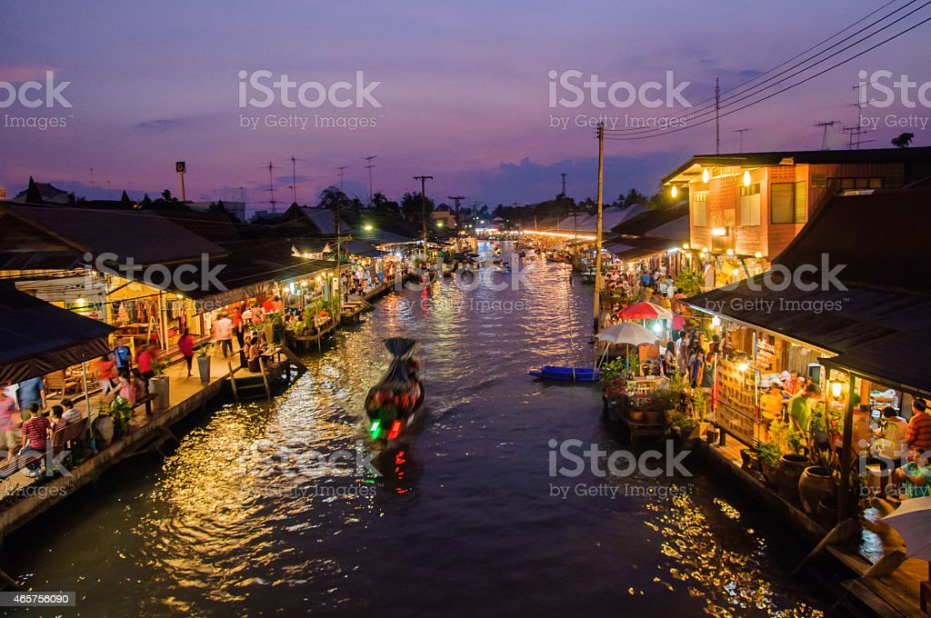 Night view of the floating market in Amphawa stock photo
