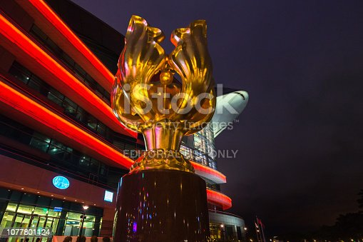 istock Night view of the Forever Blooming Bauhinia sculpture with Hong Kong Convention and Exhibition Centre on the background, Hong Kong, Wan Chai 1077801124