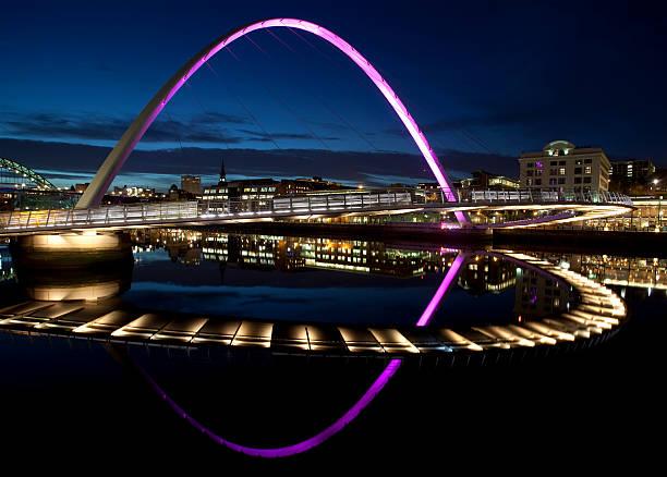 night view of the gateshead millennium bridge - gateshead stock photos and pictures