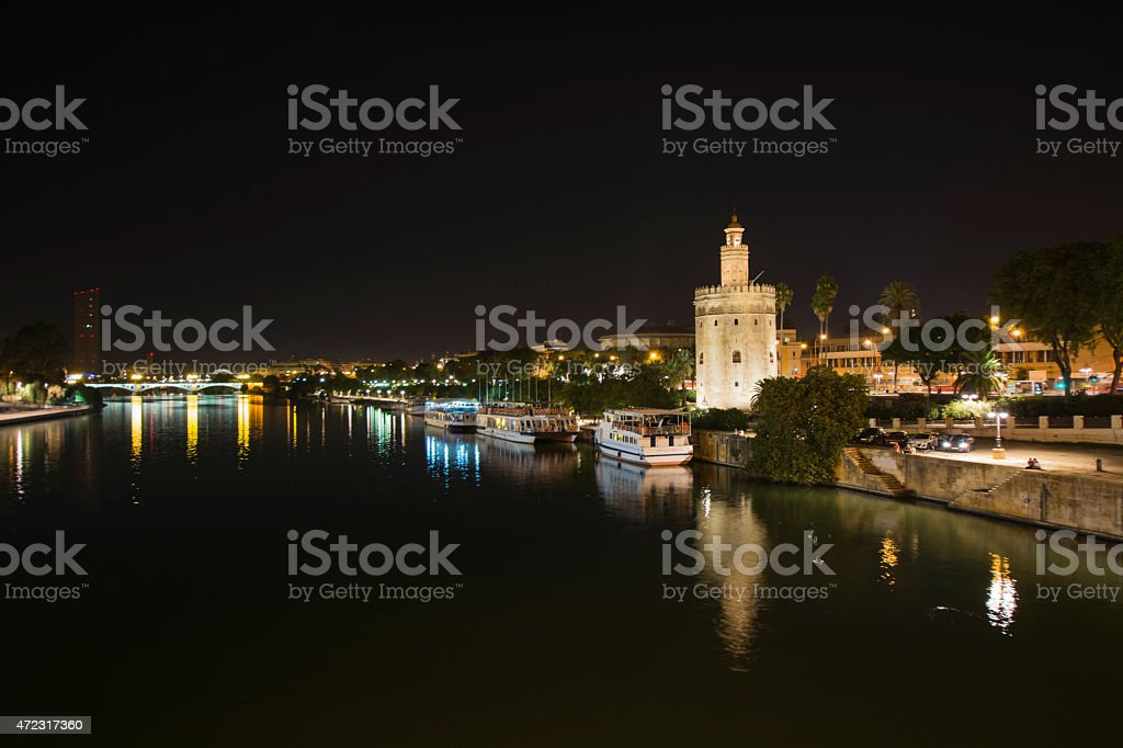 Night view of the Guadalquivir river in Seville, Spain. stock photo