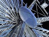 night view of the illuminated ferris wheel on Place de la Concorde in Paris.
