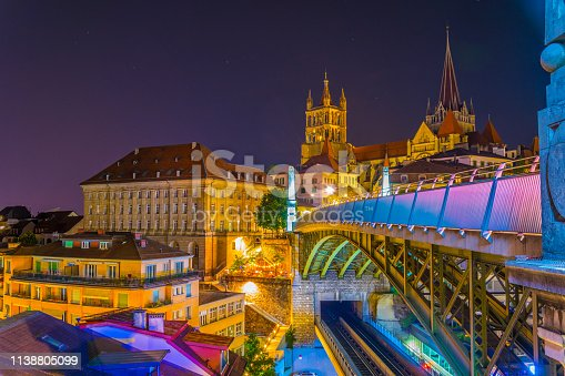 istock Night view of the Lausanne gothic cathedral Behind Charles Bessieres bridge, Switzerland 1138805099