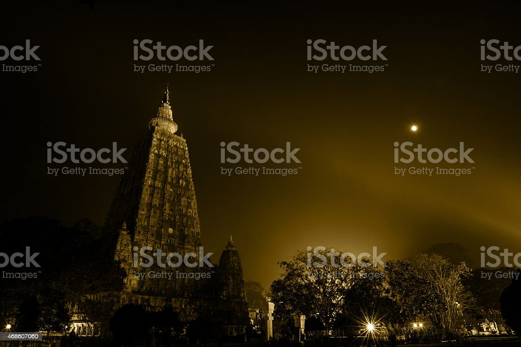 Night view of the Mahabodhi temple from afar stock photo