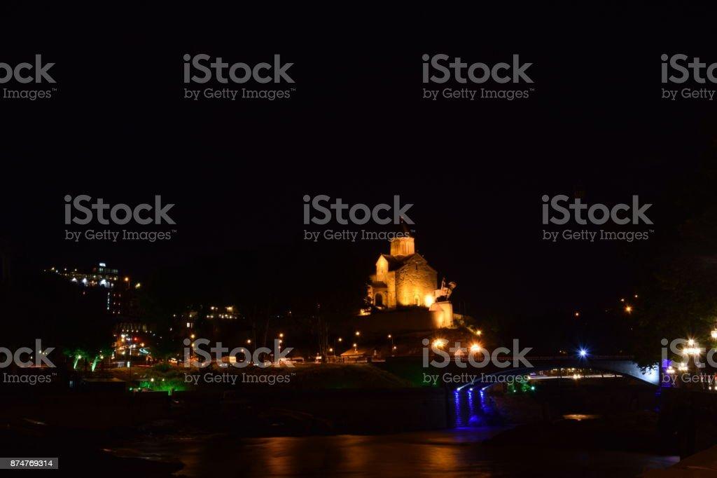 Night view of the Metekhi Church and bridge over the Mtkvari river stock photo