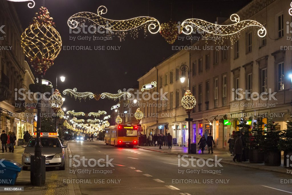 Night view of the Nowy Swiat street in Christmas decoration. stock photo
