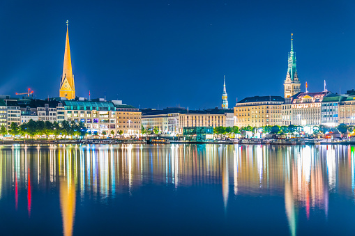 Night view of the old town in Hamburg behind binnenalster lake, Germany