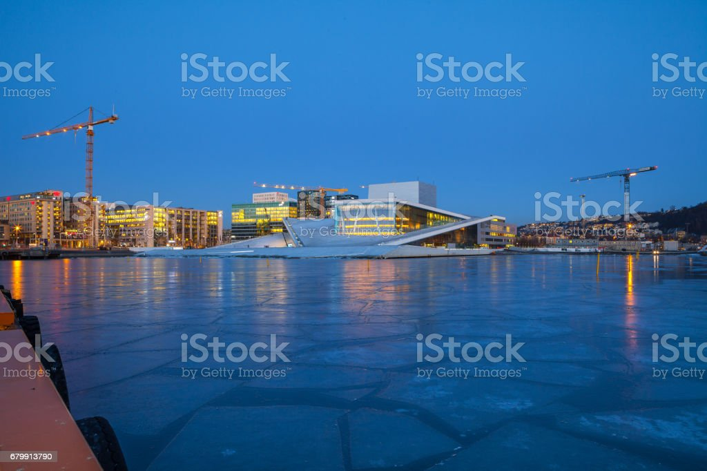 Night view of the Oslo Opera House, frozen bay and new business quarter stock photo