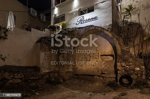 istock Night view of the ruins of an old building on the background of new buildings in the old part of Nazareth in Israel 1198255925