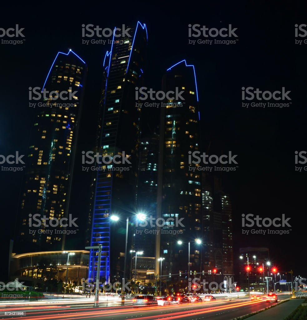 Night view of the skyscrapers in Abu Dhabi, United Arab Emirates стоковое фото