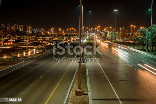 Night view of the traffic rushing through the night streets of Abu Dhabi. Car movement in the busy city of Abu Dhabi at sunset.