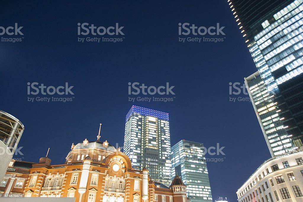 Night view of Tokyo Station and a high-rise building. royalty-free stock photo