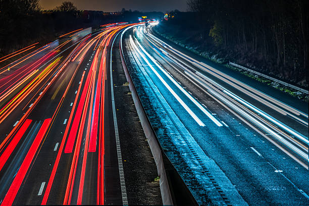 Night View of UK Motorway Highway Night View of UK Motorway Highway. multiple lane highway stock pictures, royalty-free photos & images