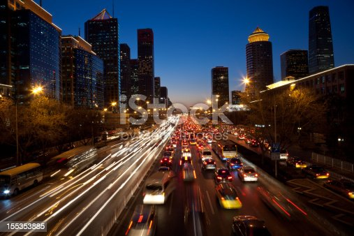 820883024 istock photo Night view of urban traffic jam in Beijing CBD 155353885