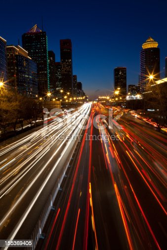 820883024 istock photo Night view of urban traffic light in Beijing CBD 155369405