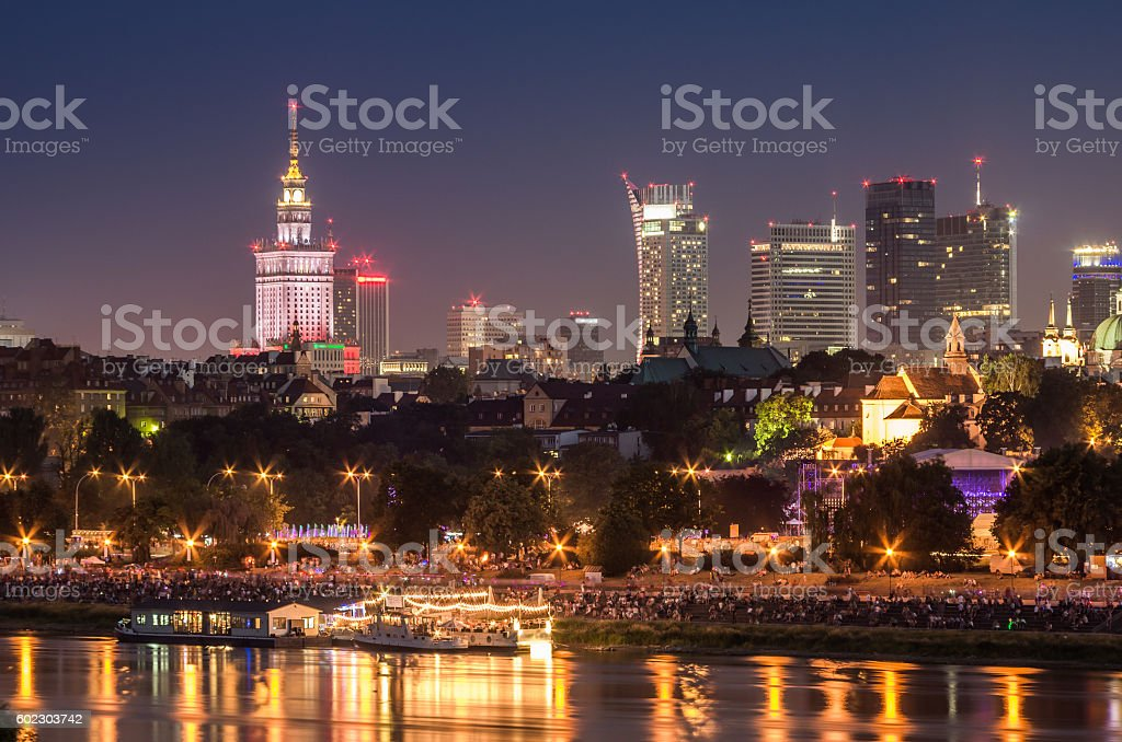 Night view of Warsaw waterfront and downtown skyline stock photo