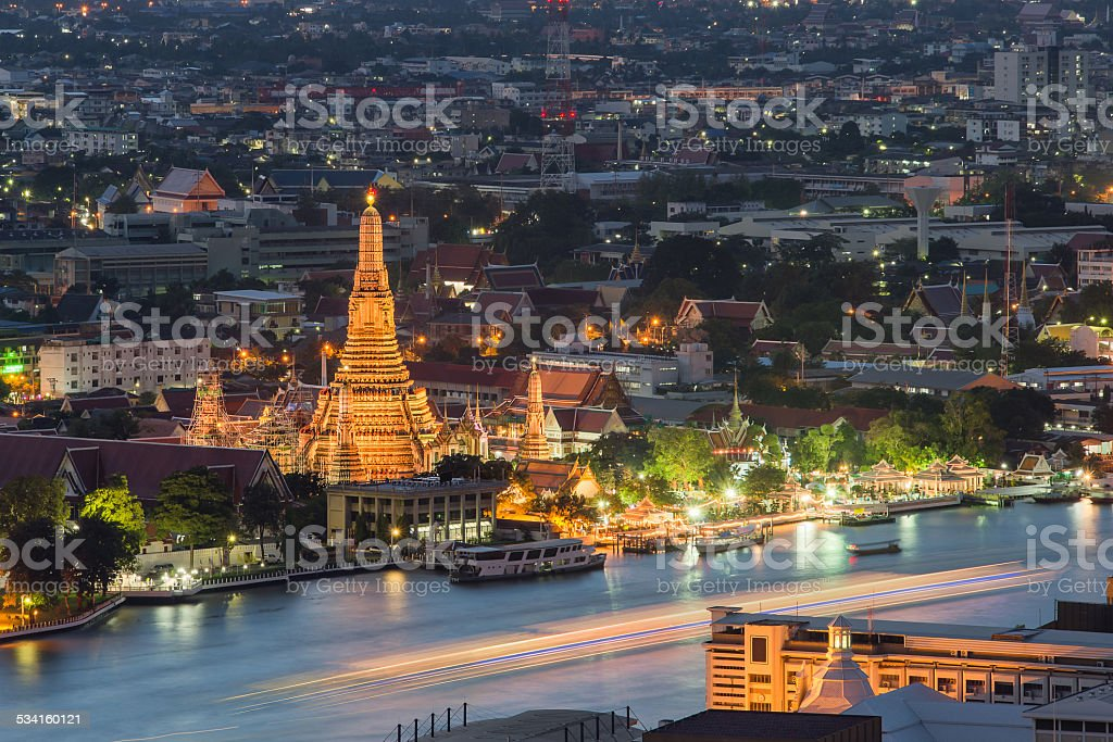 Night view of Wat Arun temple and Chao Phraya River stock photo
