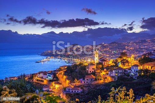 Elevated view on the district of São Gonçalo and the cityscape, harbour and surrounding mountains of Funchal on the Portugese Island of Madeira.
