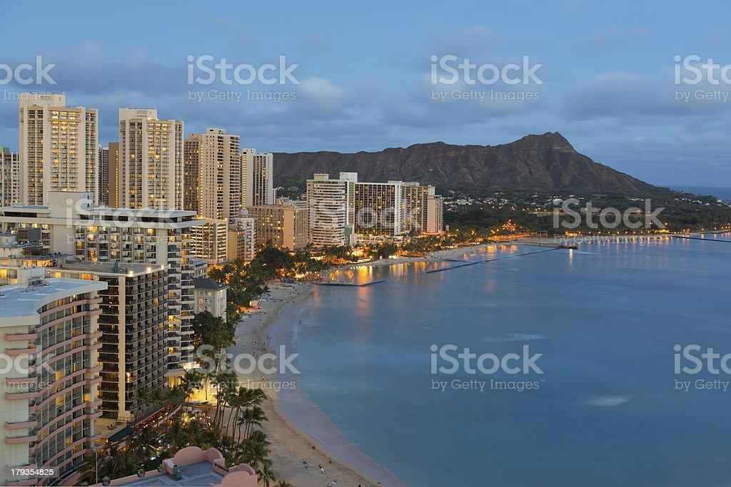 Night view on Honolulu city and Waikiki Beach royalty-free stock photo