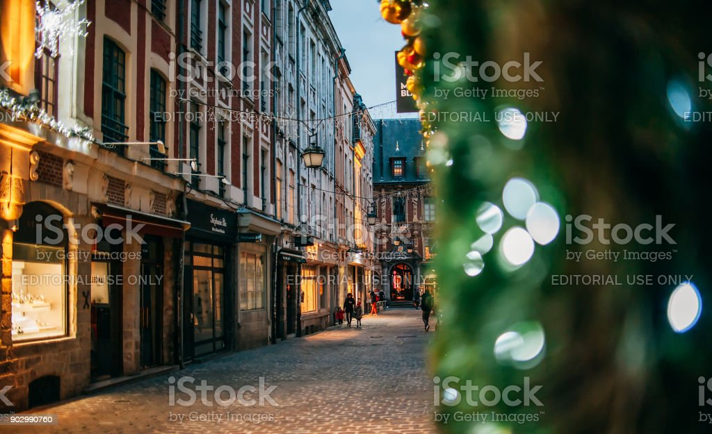 Night view on the small streets in city center with christmas decorations stock photo