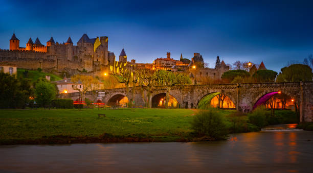 Night view over illuminated fortification of Carcassonne, France stock photo