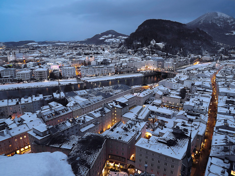 Night in winter with lot of snow over Salzburg, city known as birthplace of Mozart in Austria
