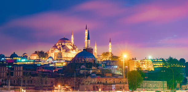 Night view to Suleymaniye Cami, from Galata Bridge, Istanbul, Turkey. stock photo