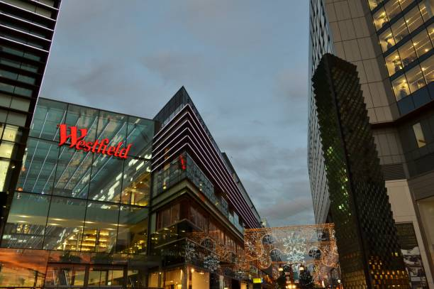 Night view to the London shopping centre Westfield Stratford City beautifully decorated in December. stock photo