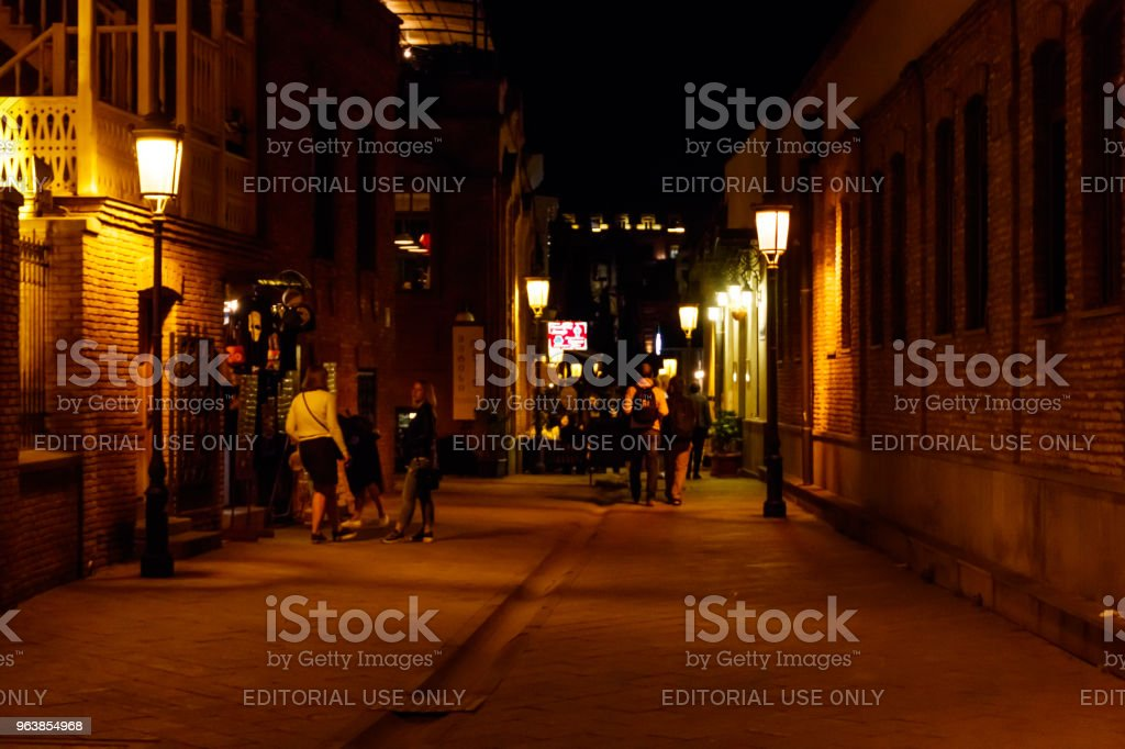 Night view to the narrow street with outdoor cafes in the historic district Old town of Tbilisi, Georgia - Royalty-free Adventure Stock Photo